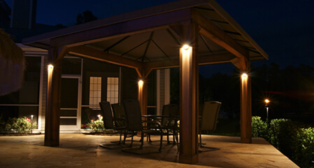 covered patio with lighting on pillars